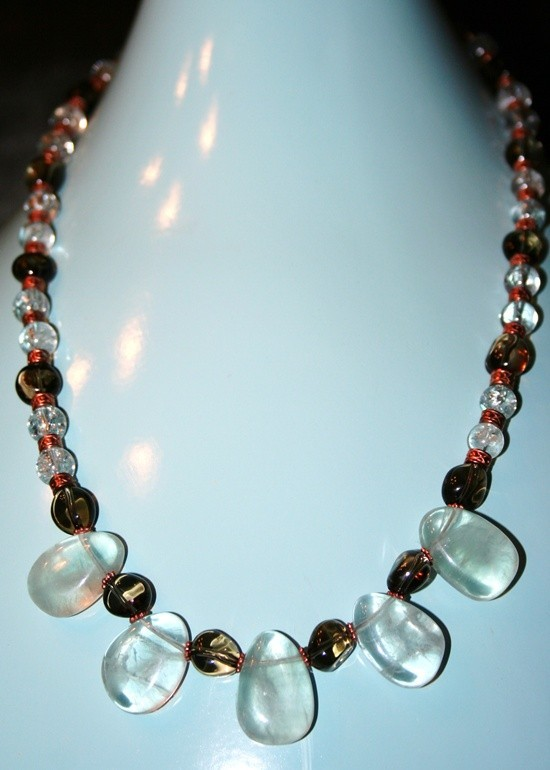 Hand made necklace with Smokey quartz and aquamarin beads spaced with copper rou