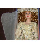 porcelain doll new in box with curly hair beige... - $0.00