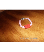 Girls Handmade Pink Bead Bracelet With Red Pendant - $2.99