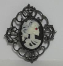 Avon Skeleton Motif Cameo Pin Red Eye Lady Mixed Materials - $16.05