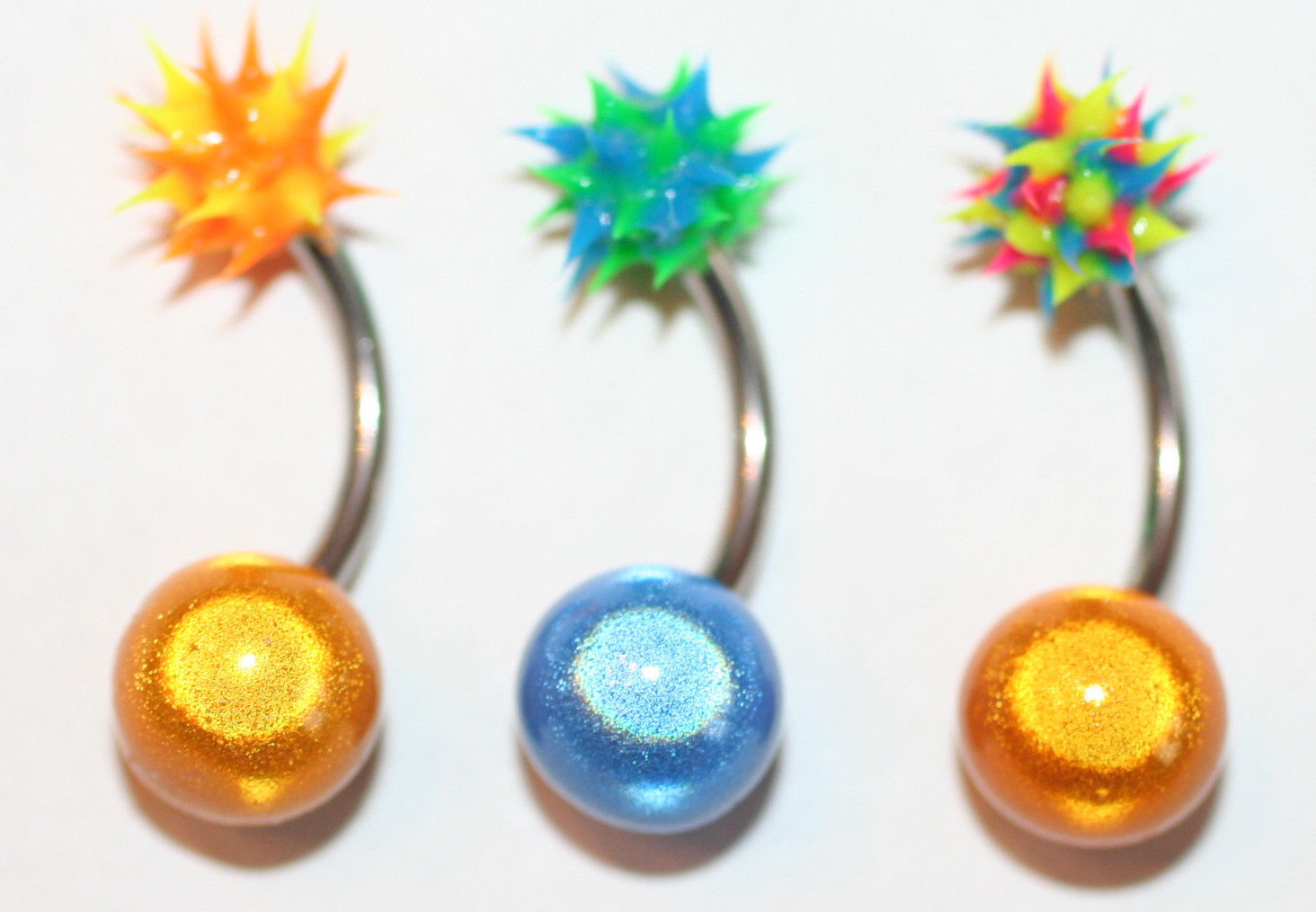 Primary image for 3 koosh ball belly rings orange blue green Dangle navel steel 14g gauge 3/8Da...