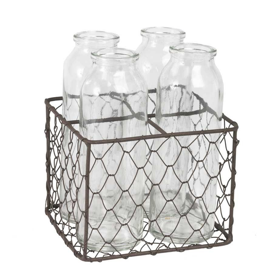 Primary image for Four Old Dairy Bottles in Metal Mesh Holder
