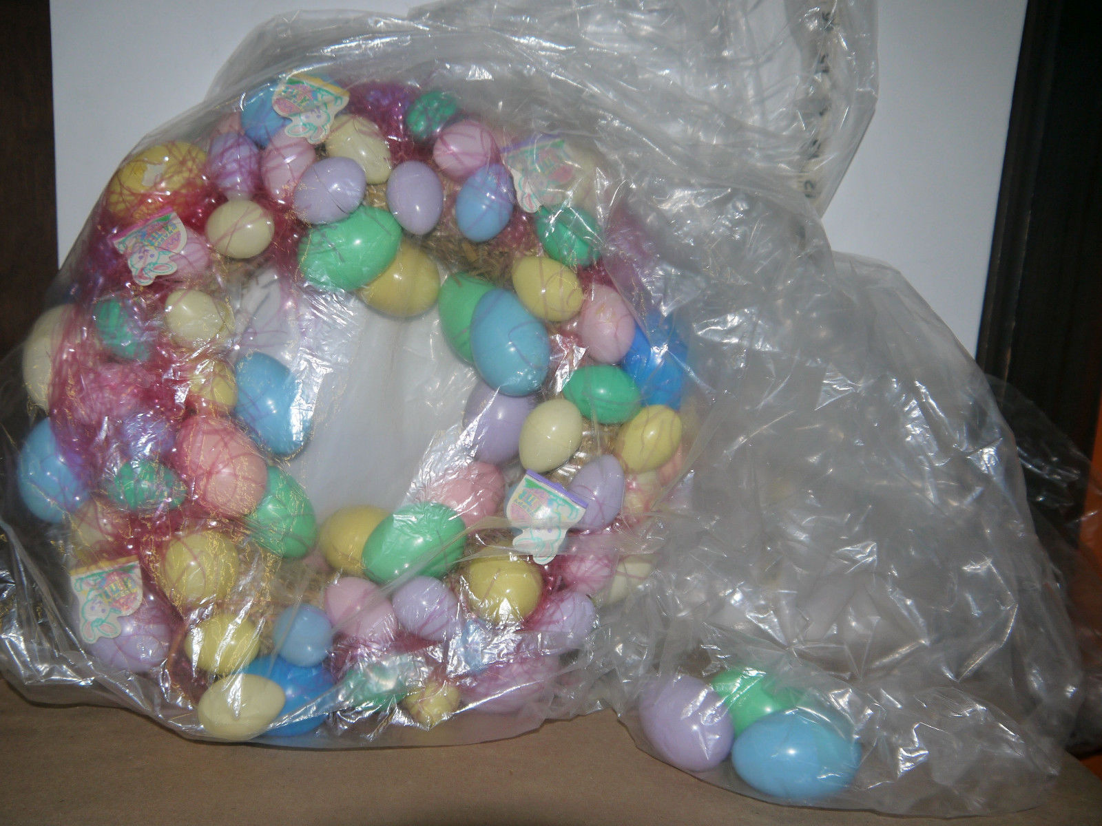 "Primary image for Easter Egg wreath 14"" diameter. Made w/ LOTS plastic eggs on a straw wreath base"