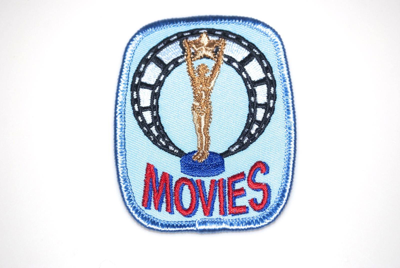 Primary image for Girl Scouts Badge Movies Blue with Oscar Statue and Film Reel