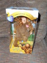 Wizard of Oz Cowardly Lion Porcelain Doll Brass Key - $50.00