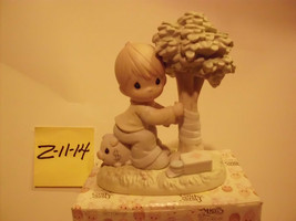 """Precious Moments """"Money's not the only Green Thing worth saving""""  figurine - $25.99"""