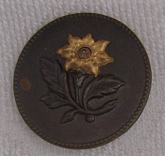 Large floral button screen center