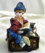It's a Small World Music Box with Boy Reading - $9.99