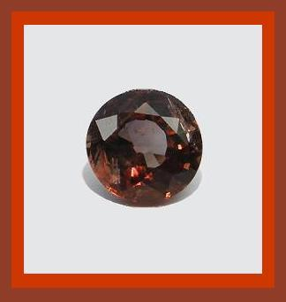 Axinite  dark brown with flashes of red  round 1.07ct 6mm