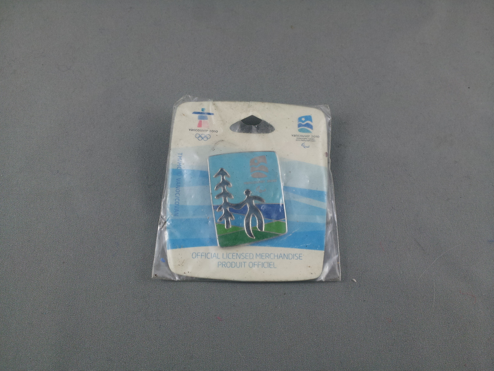 Primary image for 2010 Winter Paralympic Games Pin - Man and Tree - New in Original Packaging