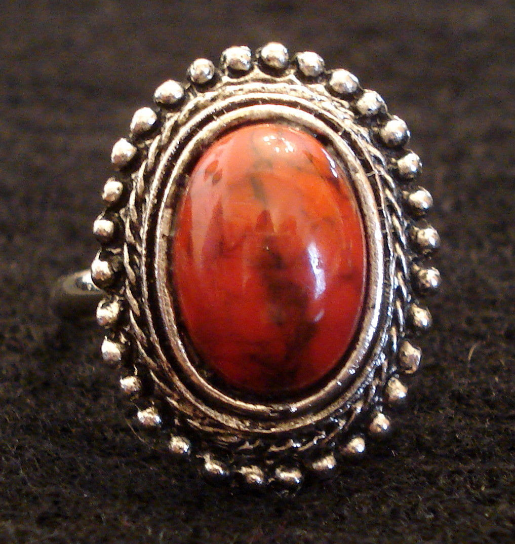 large blood orange type stone cocktail ring silver tone