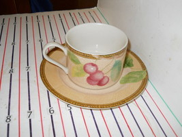 PTS INTERIORS NEWBURY   CUP AND SUACER - $4.90