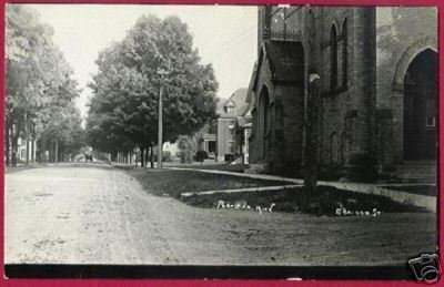 Portland Michigan E Bridge St Church 1909 RPPC MI