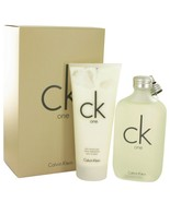 CK ONE BY CALVIN KLEIN GIFT SET -- 6.7 Oz EAU DE TOILETTE  + 6.7 OZ BODY LOTION - $35.00