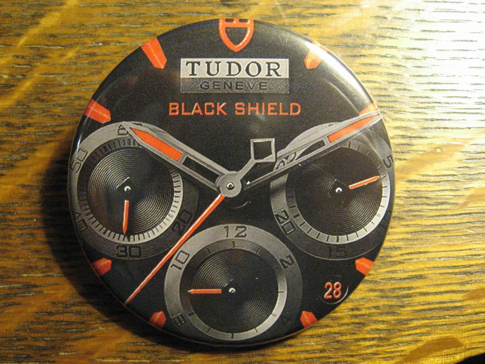 Tudor geneve black shield swiss made wrist watch advertisement lapel button pin other for Tudor geneve watches