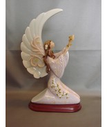 Mymicco Winged Angel Offering Up a Flower  On Wood Base - $26.90