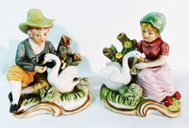 hand painted ceramic figuring boy and girl feeding swans lot of two - $39.59