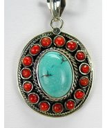 Southwestern Turquoise Oval surrounded by Red Coral Sterling Silver Pend... - $127.68