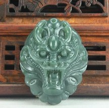 Hand carved natural green jade dragon head pendant - $9.89