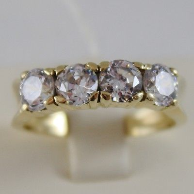 SOLID 18K YELLOW GOLD BAND RING WITH 4 CUBIC ZIRCONIA 2.40 CARATS, MADE IN ITALY