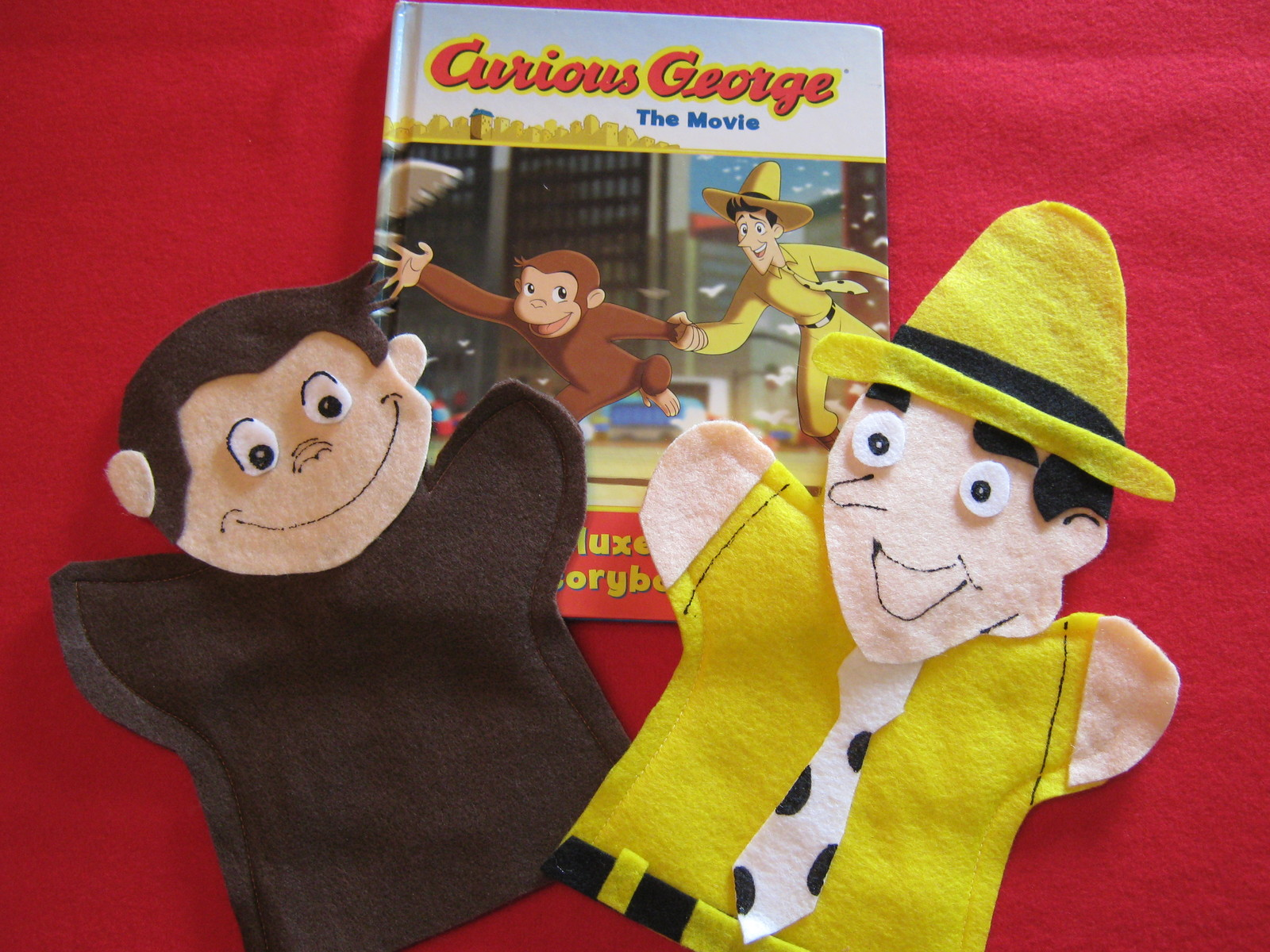 Curious George and the Man with the Yellow Hat Hand Puppets