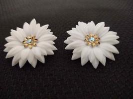 Vintage Corro clip on earrings; plastic petal flowers, metal, rhinestones. - $12.34