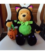Disney Plush - Halloween Pooh dressed in a Dragon costume holding a pump... - $14.00