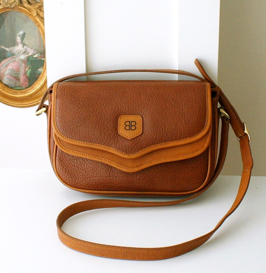 aa011d5eb01 Il fullxfull.723824708 gkr2. Il fullxfull.723824708 gkr2. vintage Balenciaga  Cow Leather Brown Shoulder Cross Hand bag ...