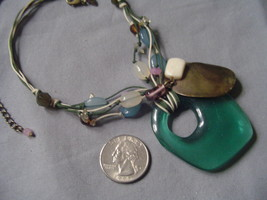 green cord neckace with pendent J27 - $18.00