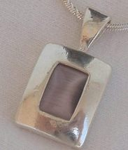 Mini purple cat eye pendant - $25.00
