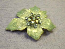 Vintage brooch pin feature with metallic green flower and rhinestone - $18.00