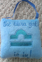 """Libra girl"" double-sided fuzzy doorknob hanger from Claire's - $7.69"