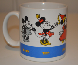 Minnie Mouse Mug Through the Ages 1928 to 1990 Disney by Applause - $19.95