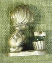 Hallmark 1975 Little Girl Looking at Flowers - $6.80