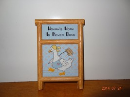 """Finished Cross stitch framed plaque that says """"Woman's work is never done"""" - $25.25"""