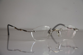 IGA OPTIC Eyewear,  Rimless Frame,  Chrome,  RX-Able Prescription Lenses. - $34.65