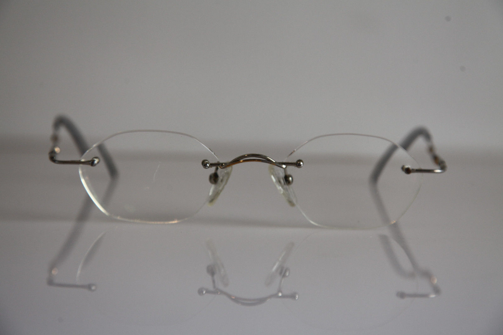 IGA OPTIC Eyewear,  Rimless Frame,  Chrome,  RX-Able Prescription Lenses.