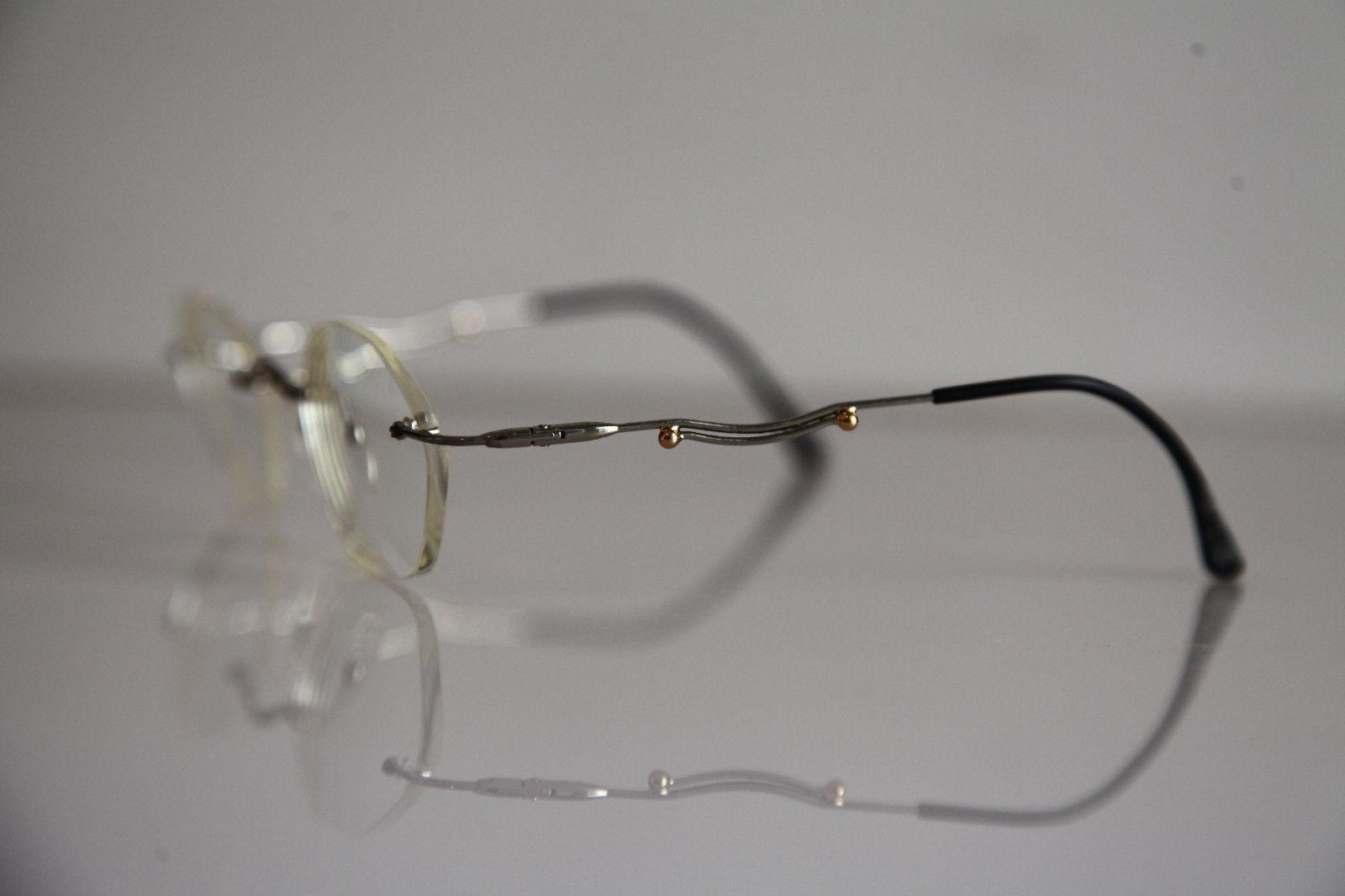 IGA OPTIC Eyewear,  Rimless Frame,  Chrome,  RX-Able Prescription Lenses.