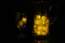 Set of 24 Litecubes Jewel Color Tinted Topaz Yellow Light up LED Ice Cubes - $52.03 CAD