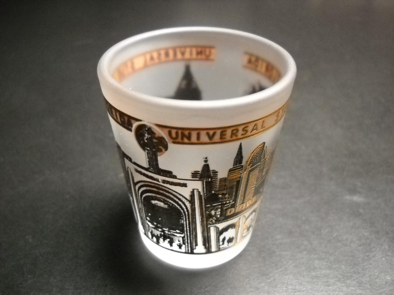 Universal Studios Florida Shot Glass Frosted Glass with Golds and Black