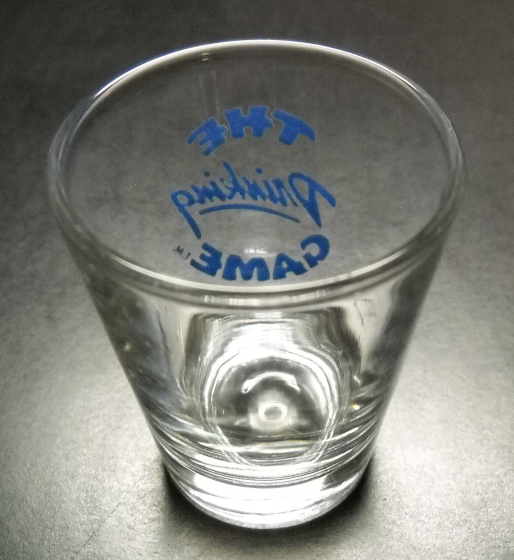 The Drinking Game Shot Glass Blue Print and Illustration on Clear Glass