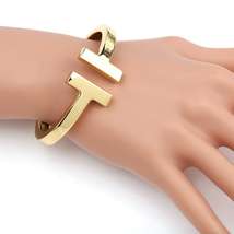 UE- Contemporary, Designer Gold Tone Hinged T-Bar Cuff Bangle Bracelet - $19.99