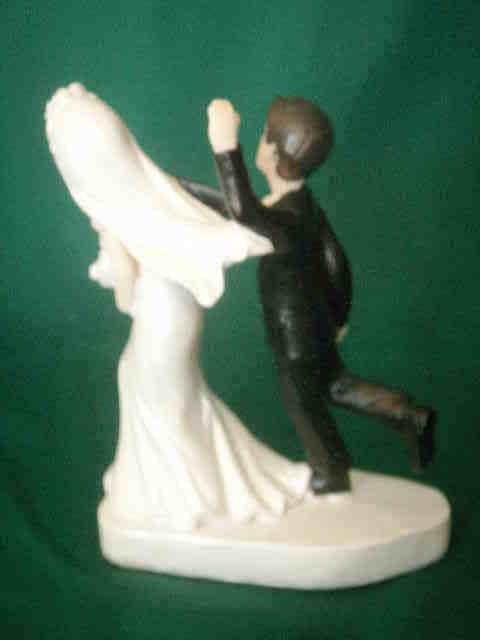 Bride and Groom Cake top funny couple whimsical tie holding bride