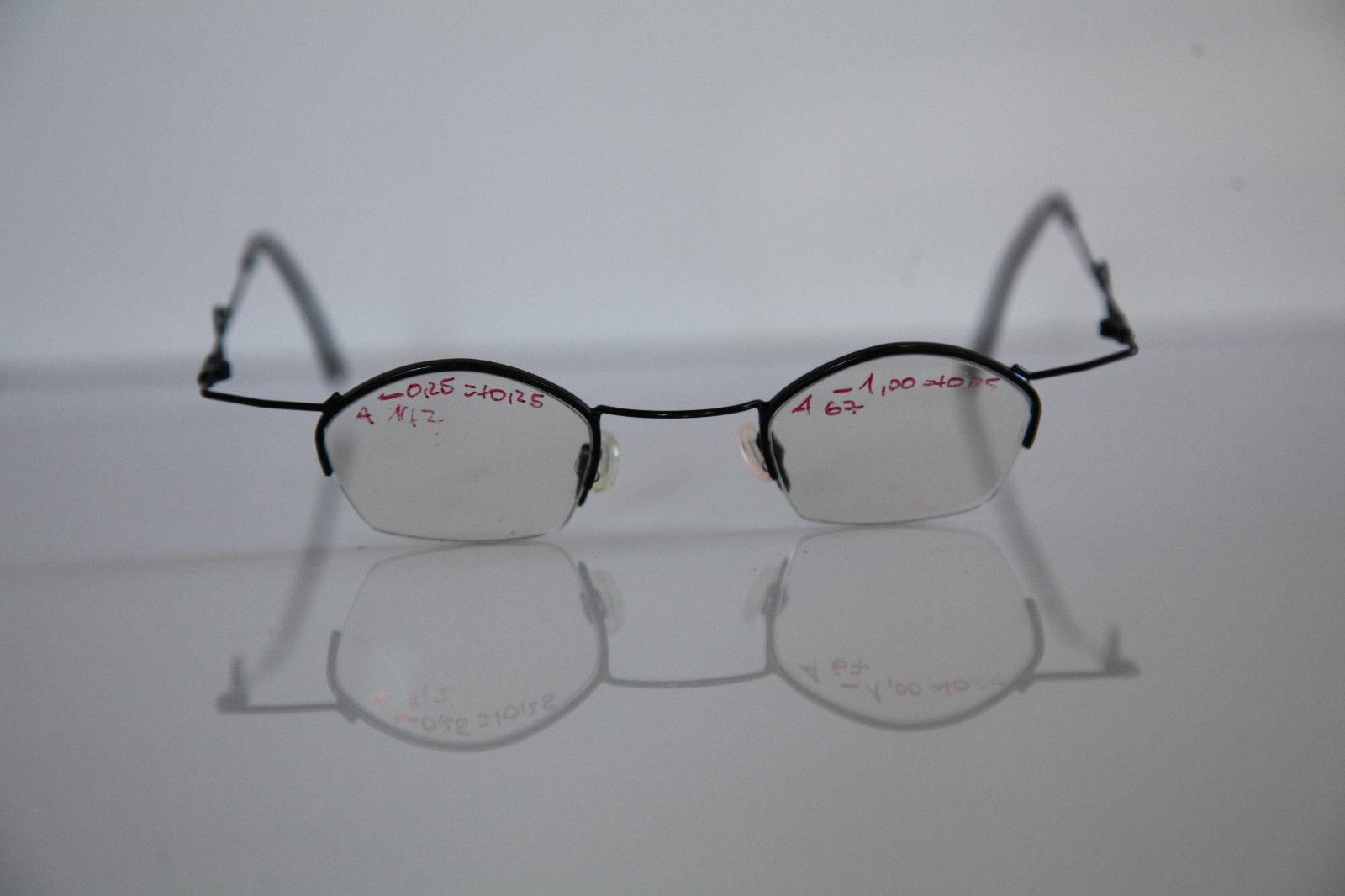 FREESTYLE ARGENTA Eyewear, Black Half Rimless Frame,   RX-Able Prescription.