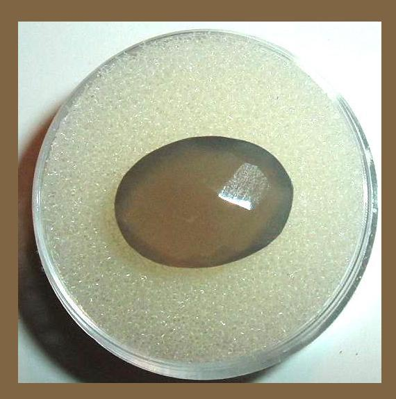 Brown moonstone oval x.xxct xmm faceted 1