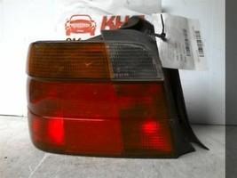 1995-2009 BMW 318i Driver Side Tail Light Hatchback     295337 - $58.00