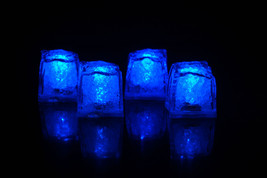 Set of 4 Litecubes Jewel Color Tinted Sapphire Blue Light up LED Ice Cubes - $12.96 CAD