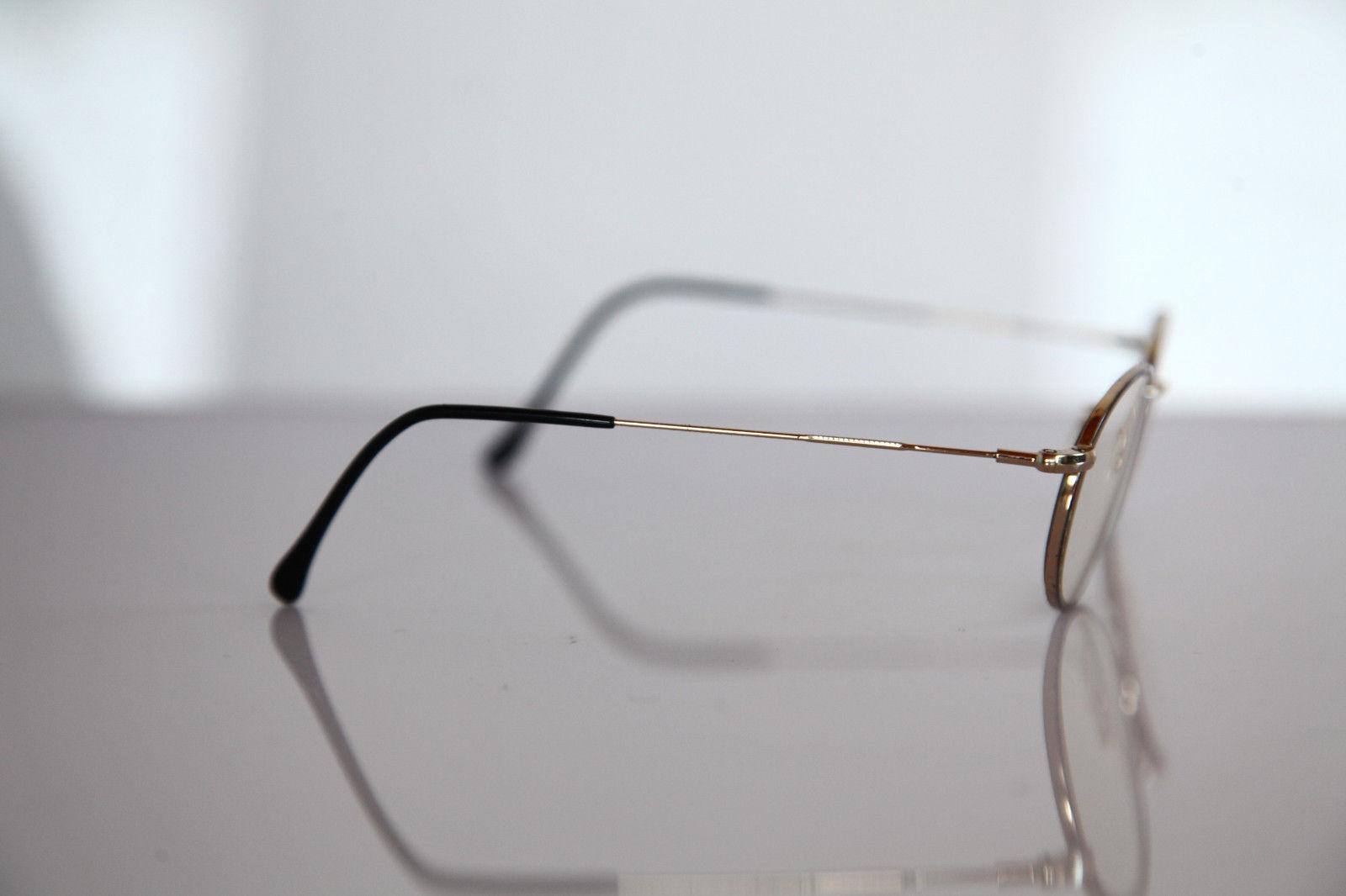 ESSILOR Eyewear, Gold, Multi-color Frame,  RX-Able Prescription Lenses.