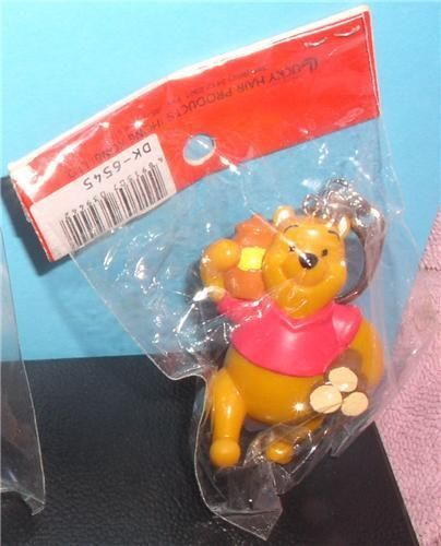 Primary image for Winnie the Pooh with logs Disney Figurine  key chain made of PVC Mint
