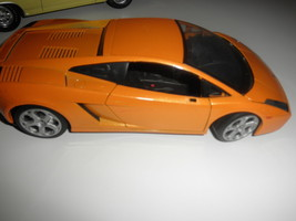lamborghini 1/18 diecast gold very nice except missing both mirrors - $22.00